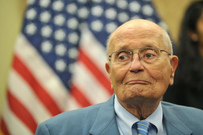 Rep. John Dingell (D-MI) attends a press conference celebrating the three year anniversary of the passing of President Obama's Affordable Care Act, on March 20, 2013 in Washington, D.C. -- UPI/Kevin Dietsch