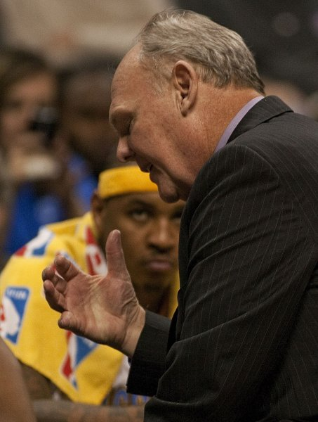 Denver Nuggets forward Carmelo Anthony watches as head coach George Karl talks in a timeout during a tough game against the Los Angeles Lakers. Photo by Gary C. Caskey/UPI