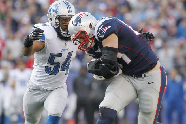 New England Patriots quarterback tight end Rob Gronkowski (87) is tackled by Detroit Lions linebacker DeAndre Levy (54) on a 15-yard reception in the second quarter at Gillette Stadium in Foxborough, Massachusetts on November 23, 2014. File photo by Matthew Healey/UPI