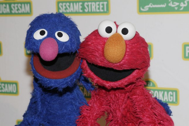 Sesame Street characters Grover (L) and Elmo pictured at the Sesame Workshop benefit gala on May 27, 2015. File Photo by John Angelillo/UPI
