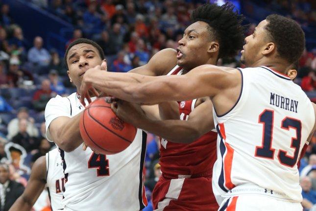 Auburn forward Chuma Okeke (4) suffered a leg injury against North Carolina in the Sweet 16. He led the Tigers with 20 points before exiting and did not return. File Photo by Bill Greenblatt/UPI