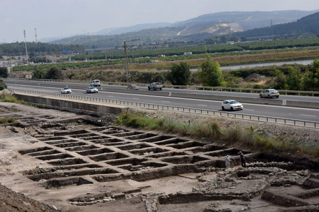 Cars drive Sunday on a highway past part of a vast 5,000-year-old cosmopolitan and planned city, one of the first and largest of the ancient Near East, excavated by the Israeli Antiquities Authority in En Esur, Israel. The archaeological site, located near Wadi Ara, was discovered before the construction of a highway interchange and revealed a massive city where 6,000 people lived. Photo by Debbie Hill/UPI