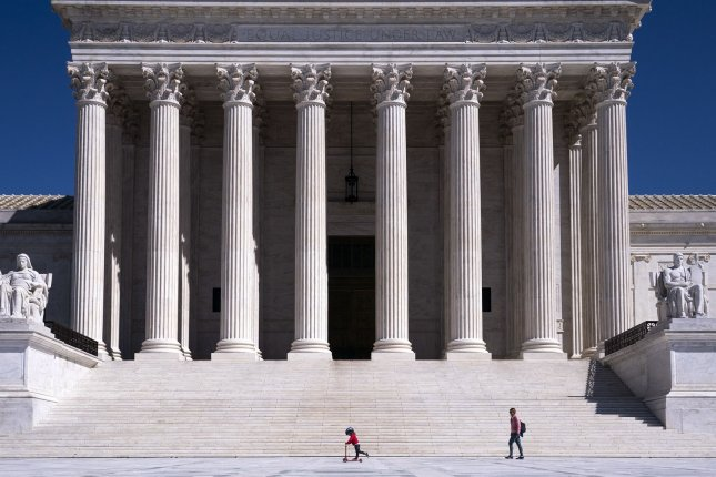 The U.S. Supreme Court, pictured on March 26. For the second day in a row, the court on Tuesday heard arguments via telephone due to the coronavirus crisis. File Photo by Kevin Dietsch/UPI