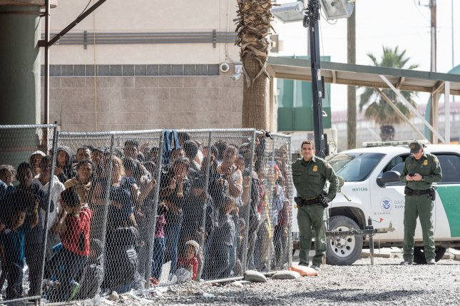 Migrants are detained by immigration authorities for processing under the Paso del Norte Bridge in El Paso, Texas, near the U.S.-Mexico border on March 27, 2019. File Photo by Justin Hamel/UPI