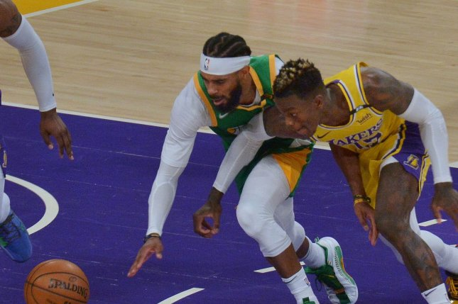 Utah Jazz point guard Mike Conley (L), shown April 19, 2021, suffered a hamstring injury in Game 5 against the Memphis Grizzlies during their first-round playoff series. File Photo by Jim Ruymen/UPI