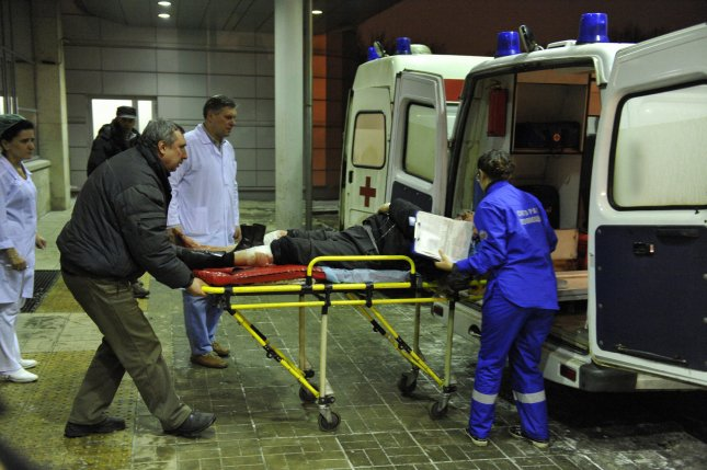 A wounded blast victim is brought by rescuers to a hospital from Domodedovo airport in Moscow on January 24, 2011. A suicide bomber killed at least 35 people and many injured at the Russian largest international airport. UPI