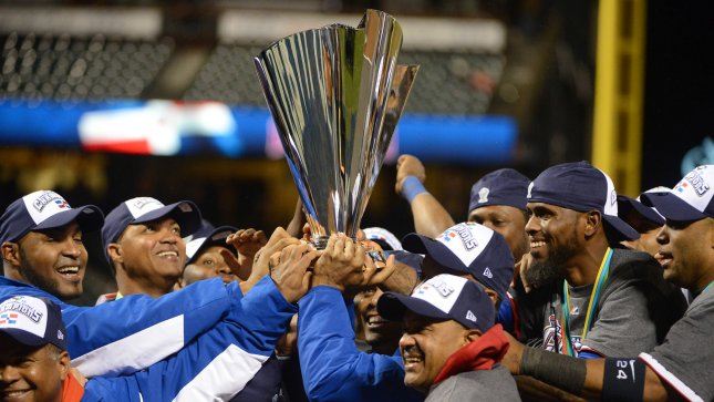 The Dominican Republic baseball team celebrates with the championship trophy at the World Baseball Classic championship at AT&T Park in San Francisco on March 19, 2013. Dominican Republic beat Puerto Rico 3-0 to win the WBC tourney. UPI/Terry Schmitt