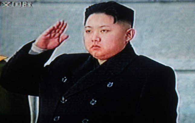 China's state television shows footage of Kim Jong Un saluting his father North Korean leader Kim Jong Il's body during a state funeral in Pyongyang Dec. 28, 2011. UPI/Stephen Shaver
