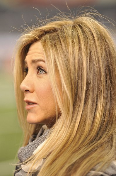 Jennifer Aniston makes a visit to the sidelines before Super Bowl XLV at Cowboys Stadium in Arlington, Texas on February 6, 2011. UPI/Brian Kersey