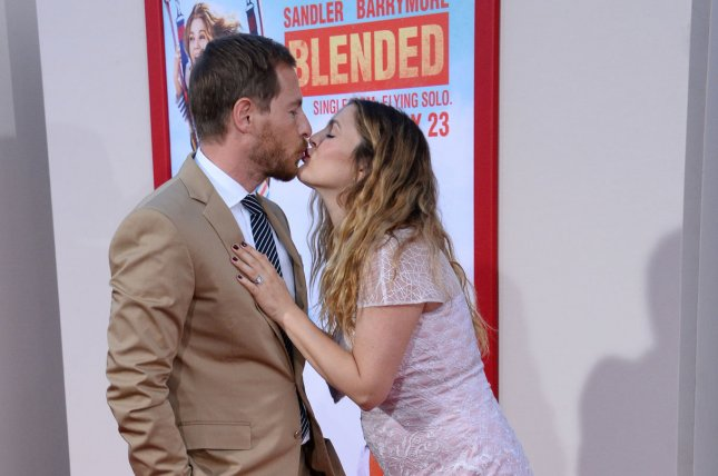 Drew Barrymore and her husband, Will Kopelman, attend the premiere of Blended in Los Angeles on May 21, 2014. File photo by Jim Ruymen/UPI
