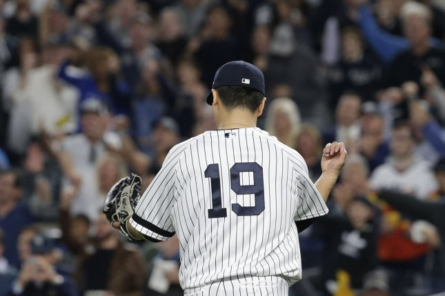 New York Yankees pitcher Masahiro Tanaka punches his baseball glove after pitching the 7th inning against the Houston Astros in Game 5 of the 2017 MLB Playoffs American League Championship Series Wednesday at Yankee Stadium in New York City. Photo by John Angelillo/UPI
