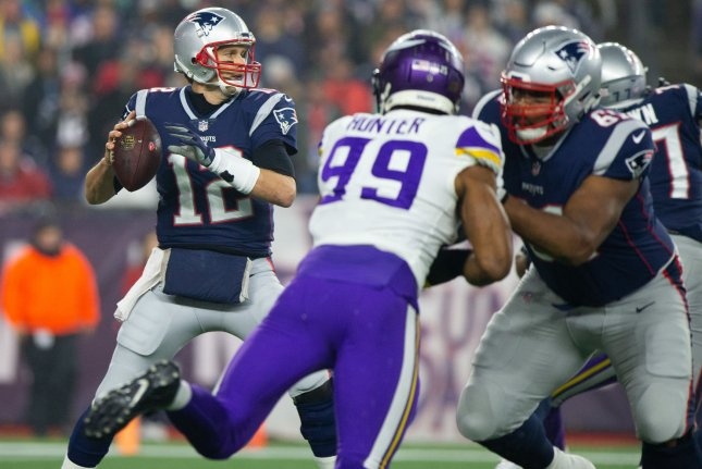 New England Patriots quarterback Tom Brady (12) drops back for a pass in the first quarter against the Minnesota Vikings on December 2, 2018 at Gillette Stadium in Foxborough, Massachusetts. Photo by Matthew Healey/UPI