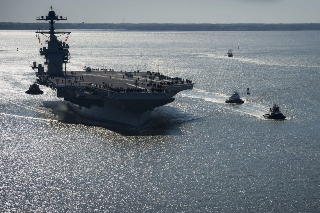 Huntington Ingalls has received an $11.5 million contract modification for repair of the USS Gerald Ford, pictured here sailing on its own power for the first time out of Newport News, Va., in 2017. File Photo by Ridge Leoni/UPI
