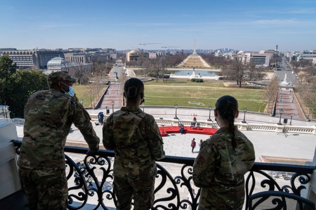 Members of the National Guard look out from the balcony of U.S. Sen. Patrick Leahy D-VT's office while he gave them a tour at the U.S. Capitol in Washington, DC on Wednesday, March 10, 2021. Photo by Ken Cedeno/UPI