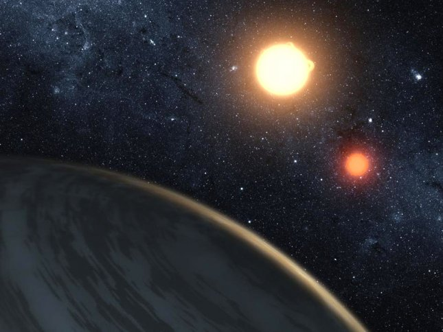 This artist's concept illustrates Kepler-16b, the first planet known to definitely orbit two stars -- what's called a circumbinary planet, it was announced on September 15, 2011. The planet, which can be seen in the foreground, was discovered by NASA's Kepler mission. The two orbiting stars regularly eclipse each other, as seen from our point of view on Earth. The planet also eclipses, or transits, each star, and Kepler data from these planetary transits allowed the size, density and mass of the planet to be extremely well determined. The fact that the orbits of the stars and the planet align within a degree of each other indicate that the planet formed within the same circumbinary disk that the stars formed within, rather than being captured later by the two stars. UPI/NASA/JPL-Caltech/T. Pylee