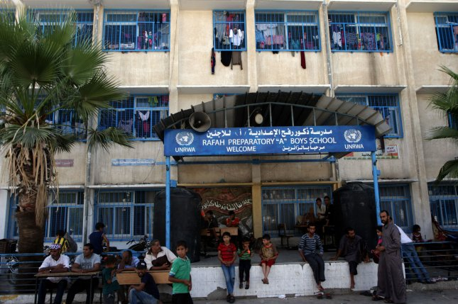 Displaced Palestinians take shelter at the United Nations school in the Rafah refugee camp in the southern Gaza Strip on July 30, 2014. Israeli bombardments early on July 30 killed dozens of Palestinians in Gaza, including at least 16 at a UN school, medics said, on day 23 of the Israel-Gaza conflict. UPI/Ismael Mohamad