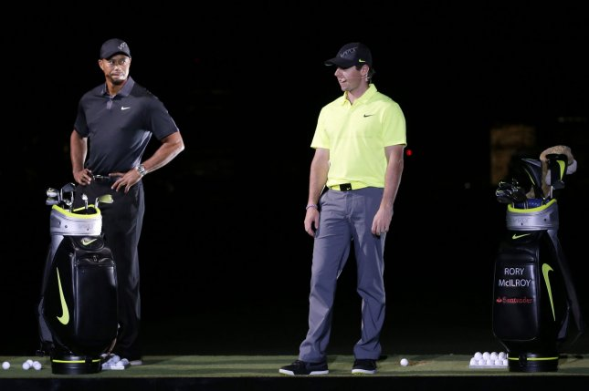 Tiger Woods stands on stage with Rory McIlroy at the launch of the new Nike Vapor Iron Franchise at Liberty National Golf Club in Jersey City, NJ on August 18, 2014. The Vapor Iron Franchise consists of 3 sets of golf club irons; The Vapor Pro, Vapor Pro Combo and Vapor Speed. Photo by John Angelillo/UPI