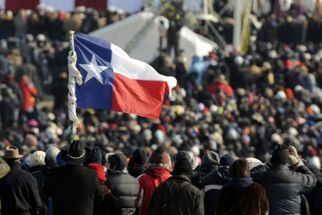 A man holds up the flag of Texas at the inauguration ceremony of Barack Obama as the 44th President of the United States in Washington, D.C., on January 20, 2009. A Texas lawmaker authored a resolution to discourage people form using the Chilean flag emoji as a substitute for the Texas state flag.