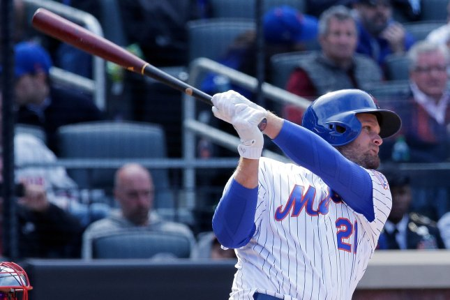 New York Mets batter Lucas Duda follows through as he hits a bases loaded double to clear the bases against the Atlanta Braves in the seventh inning of their opening day MLB game at Citi Field in New York City, April 3, 2017. File photo by Ray Stubblebine/UPI
