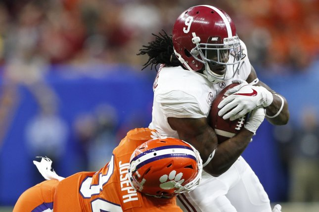 Former Alabama Crimson Tide running back Bo Scarbrough (9) gains 15 yards before Clemson Tigers linebacker Kendall Joseph (34) can make the tackle during the first quarter of the Allstate Sugar Bowl on January 1 at the Mercedes-Benz Superdome in New Orleans. Photo by AJ Sisco/UPI