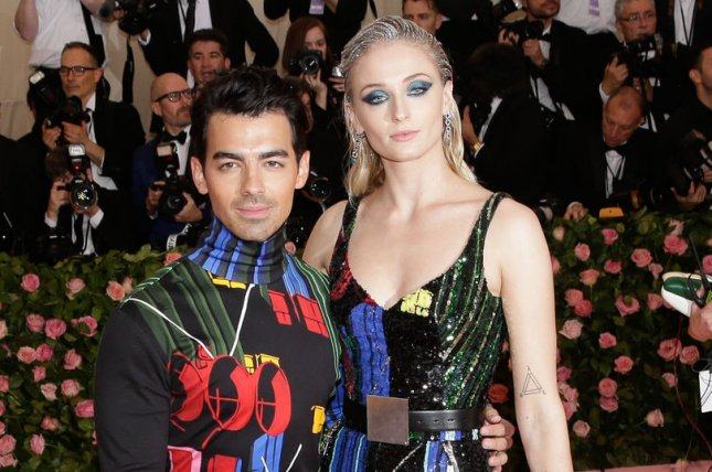 Sophie Turner (R), pictured with Joe Jonas, discussed the Game of Thrones series finale after playing Sansa Stark for eight seasons. File Photo by John Angelillo/UPI