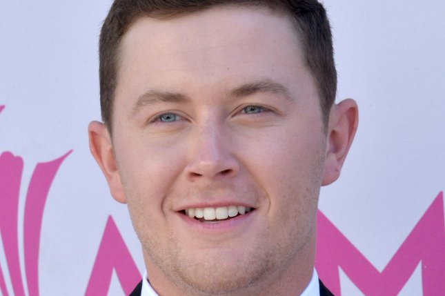 Scotty McCreery attends the 52nd annual Academy of Country Music Awards held in Las Vegas on April 2. The singer -- who has a permit to carry a concealed weapon -- has been cited for trying to bring a loaded handgun on an airplane. He says he forgot the pistol was in his bag. File Photo by Jim Ruymen/UPI