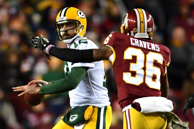 Green Bay Packers quarterback Aaron Rodgers (12) passes against former Washington Redskins safety Su'a Cravens (36) in the second quarter on November 20, 2016 at FedEx Field in Landover, Maryland. Photo by UPI