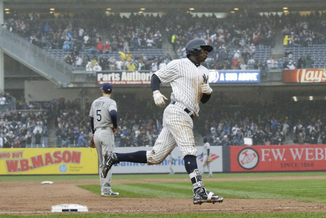 New York Yankees' Didi Gregorius hits a 3-run home run in the third inning against the Tampa Bay Rays Tuesday in the Yankees' home opener at Yankee Stadium in New York City. Photo by John Angelillo/UPI