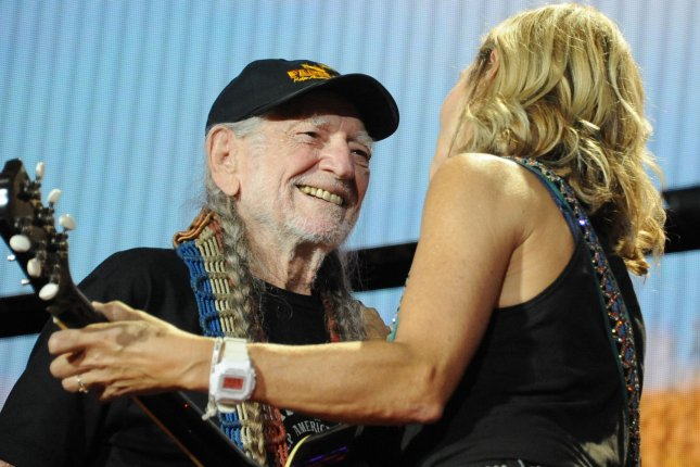 Willie Nelson (L), pictured with Sheryl Crow, will perform at his annual Farm Aid concert in September. File Photo by Archie Carpenter/UPI