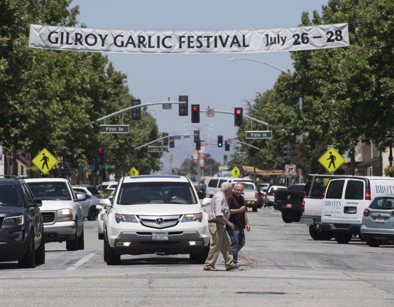 Pedestrians cross Monterey Street under a banner for the Gilroy Garlic Festival in Gilroy, Calif., on Monday. Photo by Terry Schmitt/UPI
