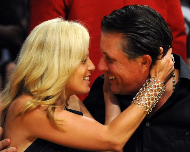 PGA Golfer Phil Mickelson is embraced by wife Amy McBride during Kiss Cam of the Houston Rockets vs Los Angeles Lakers in Game 5 of their Western Conference semifinals at Staples Center in Los Angeles on May 12, 2009. The Lakers defeated the Rockets 118-78 to lead the best-of-seven series 3-2. (UPI Photo/Jon SooHoo)