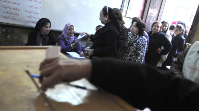 An Egyptian women prepares to cast her ballot in the country's parliamentary election in 2011. Egyptians now head to the polls to vote in presidential elections. UPI/Mohamed Hossam