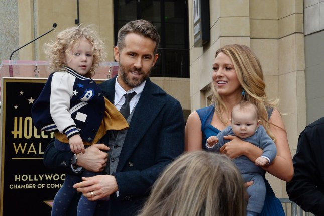 Blake Lively (R) with Ryan Reynolds and daughters James and Ines attend Reynolds' Hollywood Walk of Fame ceremony on December 15. The actress said Reynolds chose a sexy song as she gave birth to one of their daughters. File Photo by Jim Ruymen/UPI