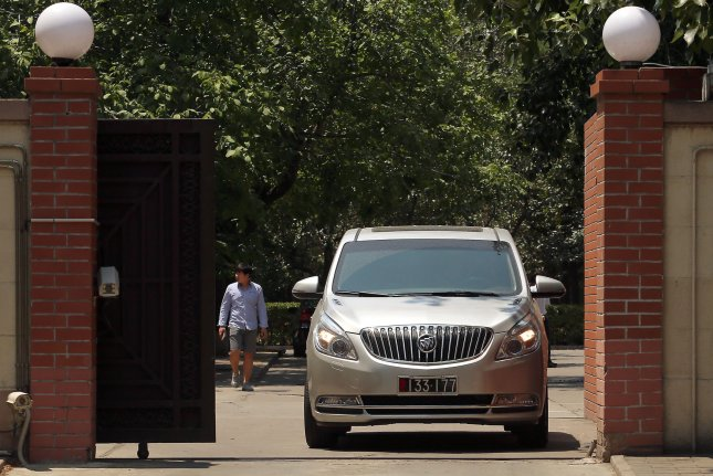 An American Buick van with North Korean diplomatic plates leaves North Korea's embassy in Beijing, China. A Pakistan-based North Korea diplomat returning from a trip to the city filed a complaint after his home was broken into and high-value goods confiscated by local police. File Photo by Stephen Shaver/UPI