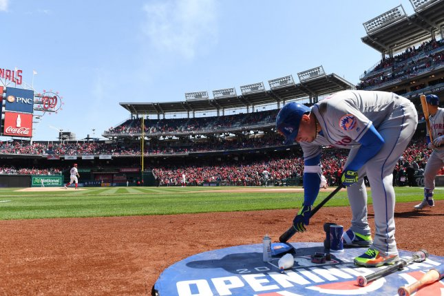 Former New York Mets infielder Asdrubal Cabrera warms up with Washington Nationals starting pitcher Stephen Strasburg on the mound on April 5 at Nationals Park in Washington, D.C. Photo by Pat Benic/UPI