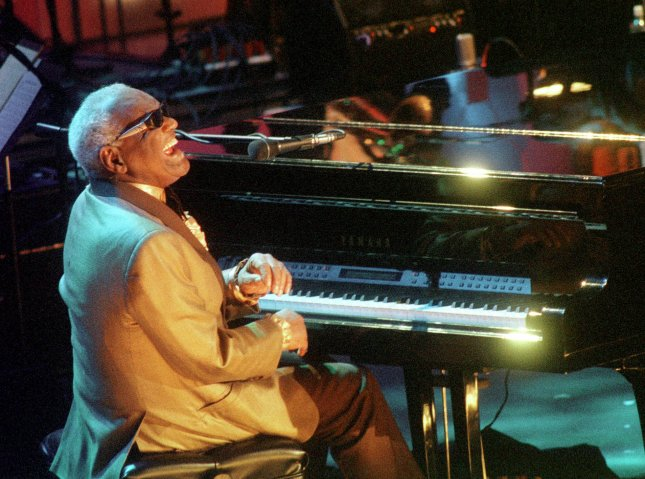 Singer Ray Charles performs a tribute to Rock and Roll Hall of Fame inductee Nat King Cole during ceremonies in New York on May 6, 2000. Charles died on this day in 2004. File Photo by Ezio Petersen/UPI