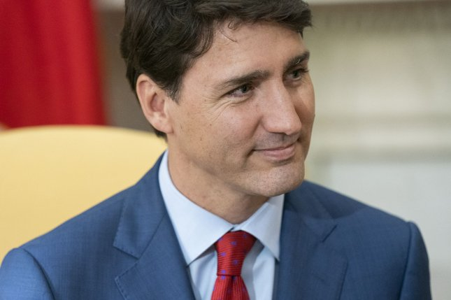 Canadian Prime Minister Justin Trudeau said Wednesday he would take responsibility for his actions in the SNC-Lavalin scandal after an ethics board found he exerted improper political pressure. File Photo by Jim Lo Scalzo/UPI