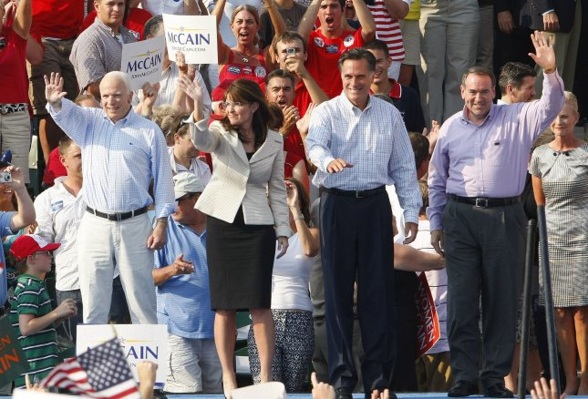 Former Govs. Mike Huckabee (R) and Mitt Romney (2nd from right) join Republican President and Vice Presidential candidates Sen. John McCain and Gov. Sarah Palin on stage during a rally at the T.R. Hughes Ballpark in O'Fallon, Missouri on August 31, 2008. (UPI Photo/Bill Greenblatt)