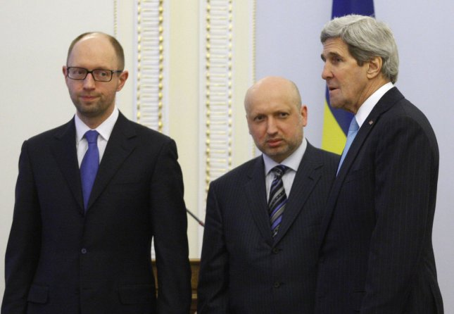 U.S. Secretary of State John Kerry (R) meets with Ukrainian Prime Minister Arseniy Yatsenyuk (L) and and Acting President Oleksandr Turchynov in Kiev on March, 4, 2014. Kerry announced a $1 billion economic package in support of the new government, while Russian President Vladimir Putin says he reserves the right to use force in the Ukraine as a last resort. UPI/Ivan Vakolenko