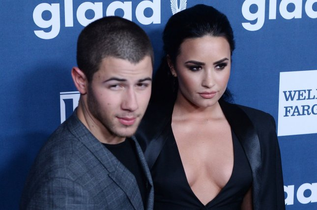 Recording artist Nick Jonas (L) and honoree Demi Lovato attend the 27th annual GLAAD Media Awards on April 2, 2016. File Photo by Jim Ruymen/UPI