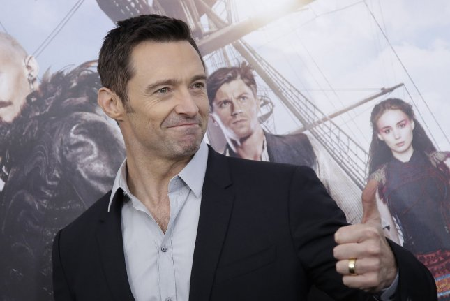 Wolverine star Hugh Jackman gives a thumbs up when he arrives on the red carpet for the premiere of Pan at the Ziegfeld Theater on October 4, 2015 in New York City. X-Men filmmakers Bryan Singer and Simon Kinberg said that villian Mister Sinister will be making an appearance in the upcoming Wolverine 3. File Photo by John Angelillo/UPI
