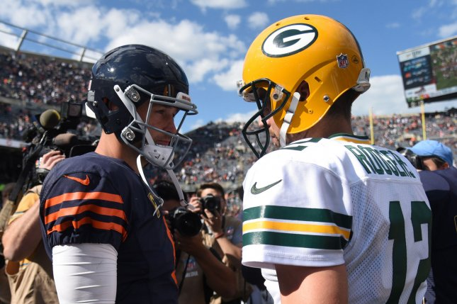 Green Bay Packers quarterback Aaron Rodgers and Chicago Bears quarterback Jay Cutler shake hands at Soldier Field on September 13, 2015 in Chicago. Photo by David Banks/UPI