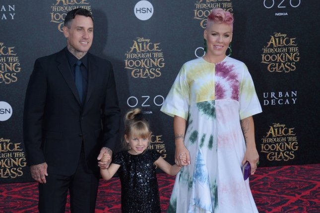 Pink (R) with Carey Hart (L) and daughter Willow at the Los Angeles premiere of Alice Through the Looking Glass on May 23, 2016. The singer shared a photo Monday from son Jameson's first bike ride. File Photo by Jim Ruymen/UPI