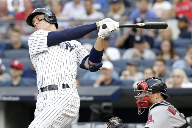 New York Yankees Aaron Judge takes a swing at a pitch and misses in the 7th inning against the Boston Red Sox at Yankee Stadium in New York City on August 12, 2017. File photo by John Angelillo/UPI
