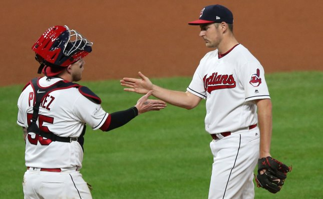 Cleveland Indians pitcher Trevor Bauer is greeted by catcher Roberto Perez as Bauer is relieved during the seventh inning of the American League Division Series Game 1 against the New York Yankees. Photo by Aaron Josefczyk/UPI