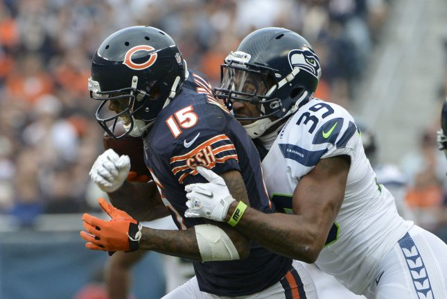 Former Seattle Seahawks cornerback Brandon Browner (39) pops the ball out of the hands of ex-Chicago Bears wide receiver Brandon Marshall (15) during the second quarter on December 2, 2012 at Soldier Field in Chicago. File photo by Brian Kersey/UPI