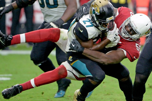 Arizona Cardinals defensive end Chandler Jones tackles Jacksonville Jaguars running back Leonard Fournette during a game last season. Photo by Art Foxall/UPI