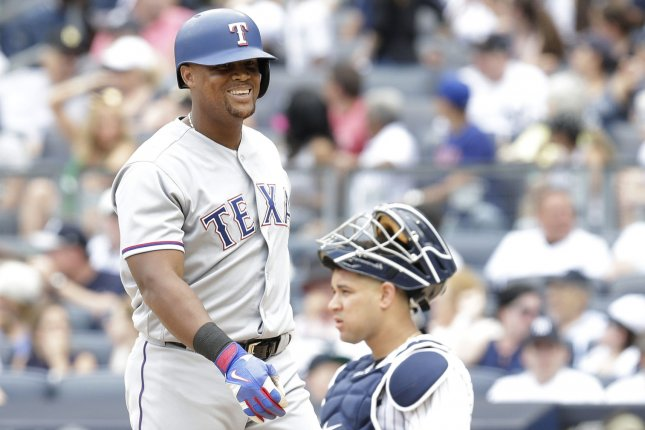Former Texas Rangers star Adrian Beltre smiles at home plate. File photo by John Angelillo/UPI