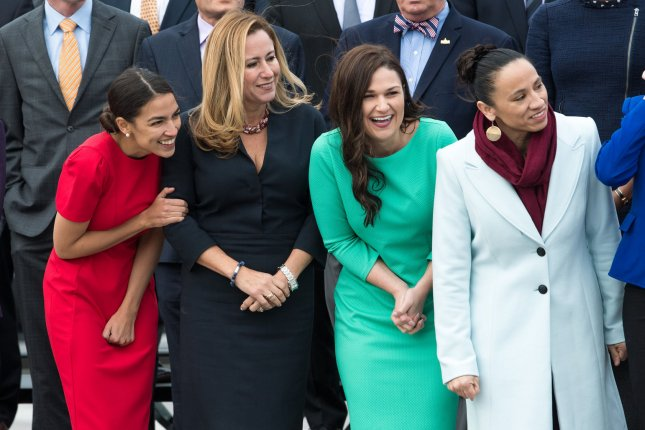 U.S. Reps.-elect, from left to right, Alexandria Ocasio-Cortez, D-N.Y., Debbie Mucarsel-Powell, D-Fla., Abby Finkenauer, D-Iowa, and Sharice Davids, D-Kan., wait for the group photo for the new members of the 116th Congress on November 14. Photo by Kevin Dietsch/UPI