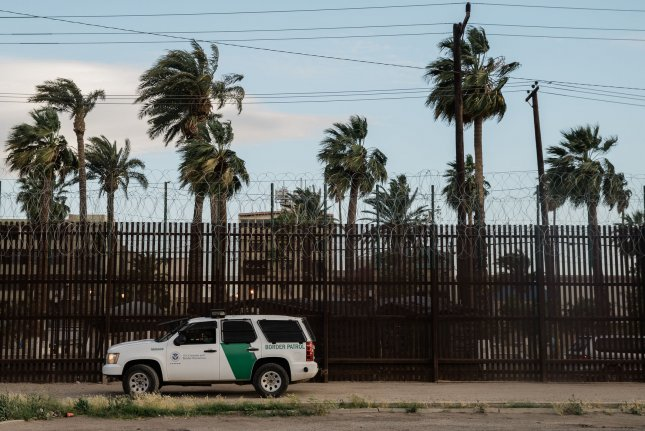 A border patrol vehicle is seen in front of the security fence in Calexico, Calif., that separates the United States and Mexico. File Photo by Ariana Drehsler/UPI